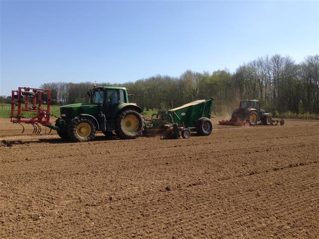 Tractors cultivating the land in preparation for the allotments