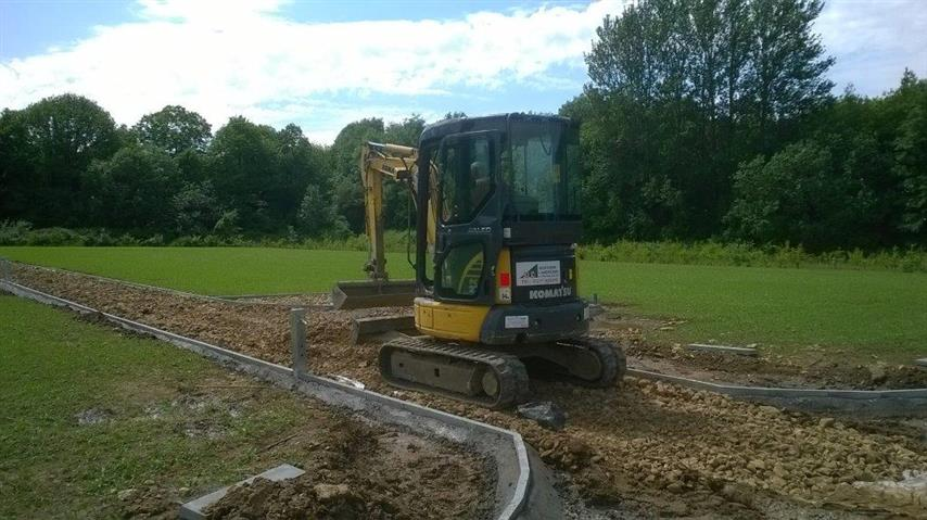 A digger preparing the ground for the allotments